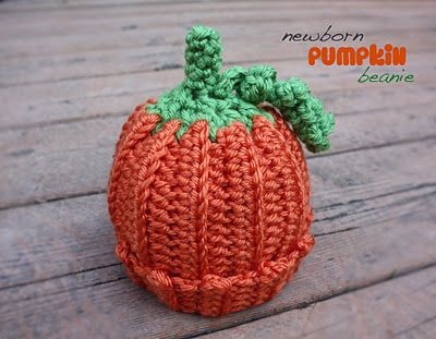 Newborn size pumpkin beanie stuffed with a newborn size halloween-themed onesie. The perfect gift for a little October baby!