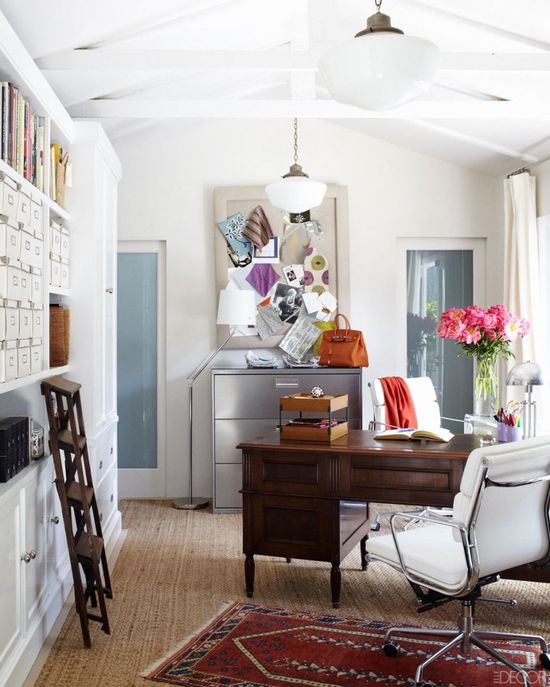 Claudia Benvenuto bungalow office, layered rugs, antique desk, modern chair, bookcases, vintage ladder, Elle Decor - love the office chairs!