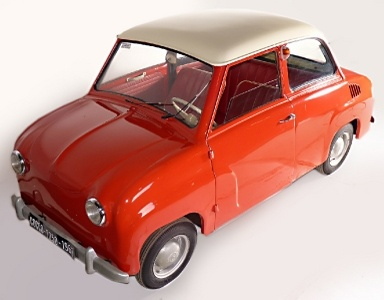 1962 Goggomobil T250 - The T250 was a conventional-looking two door sedan with a rear-mounted 245 cc air cooled two-stroke straight twin engine.     Design changes were made to the T250 in 1957. Two windshield wipers were used instead of the earlier system with one wiper, and the sliding windows in the doors were changed to wind-up windows. The last design change for the T sedan came in 1964, when the rear-hinged suicide doors were replaced by conventional front-hinged doors.