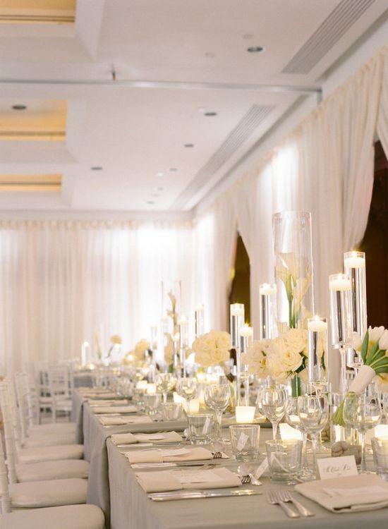 all white reception- white draping, white table linens, white centerpieces