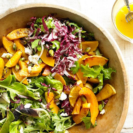 delicious fall salad topped with caramelized squash and goat cheese.