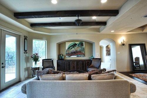Decorative cedar beam ceiling treatment.