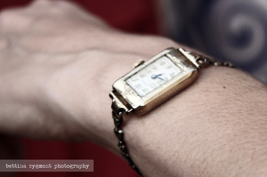 The bride's something old, something borrowed - an old watch, a family heirloom