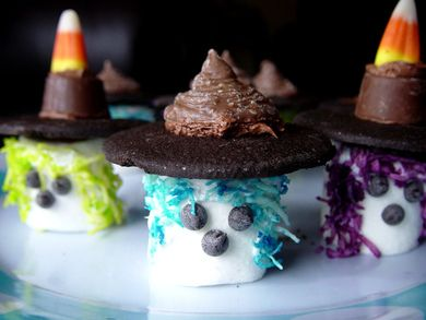Super fun little Cookie Topped Halloween Marshmallow Witches. #witch #marshmallow #candy #cookies #candy_corn #Halloween #food #baking #cooking #dessert #autumn #fall