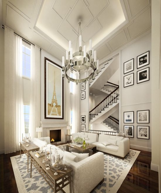 Great high ceilings, great lighting, great wall art, great staircase zigzagging in the background, great rug - what more can you ask for?
