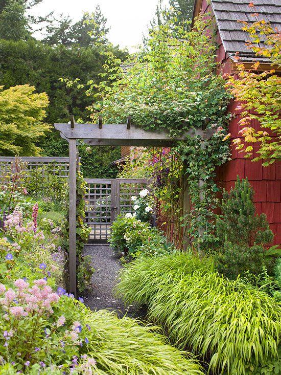 Add an arbor or trellis to complement a lush garden. More gorgeous garden ideas: www.bhg.com/...