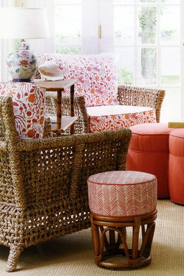 love the mix of patterns and pretty oranges love the little side table