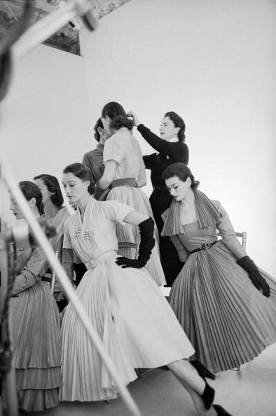 """Vogue magazine editor Bettina Ballard directing models for a photoshoot at a studio in Paris, France, February 1951."" #vintage #fashion #1950s #hat #dress"