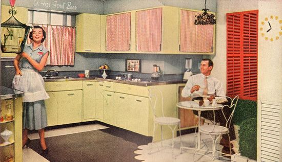 A couple enjoying the morning in their lovely cafe inspired 1950s kitchen. #homemaker #1950s #kitchen