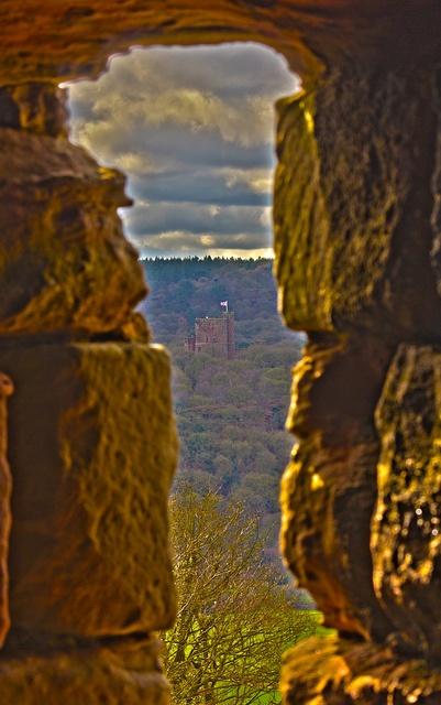 Peckforton Castle seen through one of the windows at Beeston Castle. England