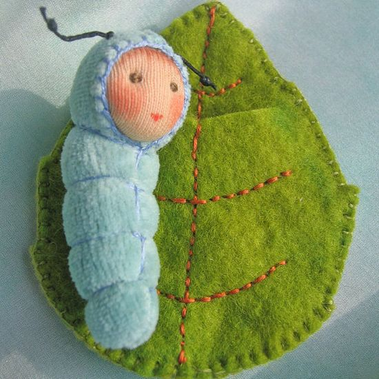 Baby Caterpillar in a leaf bed (etsy)