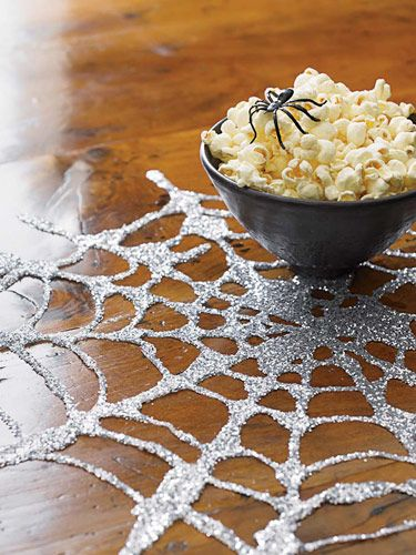 make your own spider web out of glue and glitter
