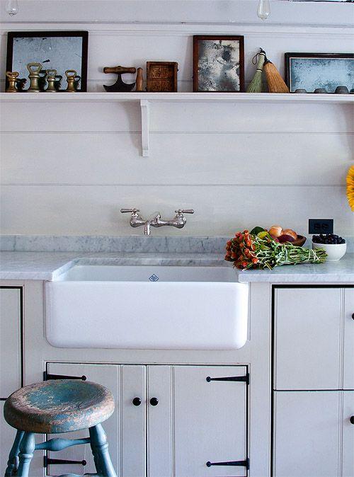 original farmhouse sink + marble counter + open shelf