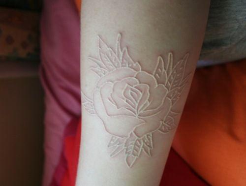 white ink flower tattoo