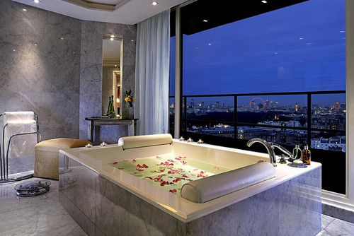 ah flower petals in the tub with an awesome view ah ah ?