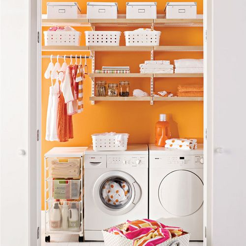 Laundry Room - the white bins against the orange wall? love it.