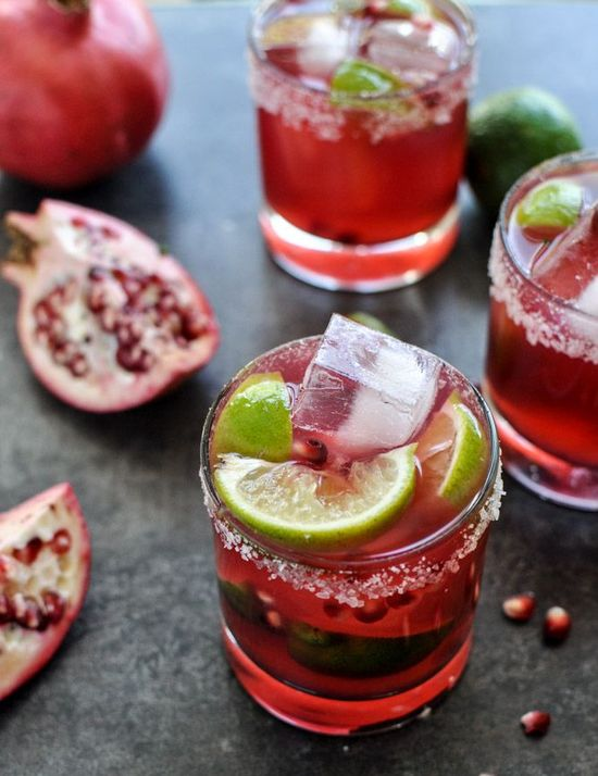 Christmas come early...pomegranate margaritas: 2 ounces Grand Marnier  1 1/2 ounces Tequila  2 ounces pomegranate juice  2 ounce lime juice   1 1/2 ounces simple syrup  coarse salt for the rim  lime + pomegranate arils for garnish
