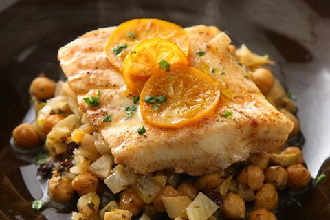 Steamed Fish with Chickpeas and Currants by chow.com via buzzfed: MARINADE: oil + cumin + cinnamon + sumac + 30 minutes #Marinade #Fish #Steamed #Chickpeas #Currants