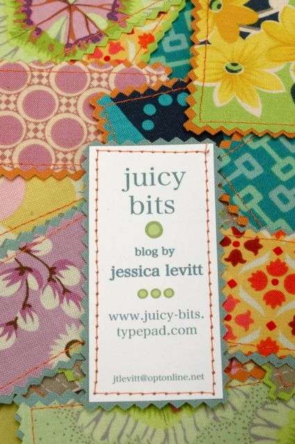 Cute little business cards with fabric rectangles pinked and sewed on the backs