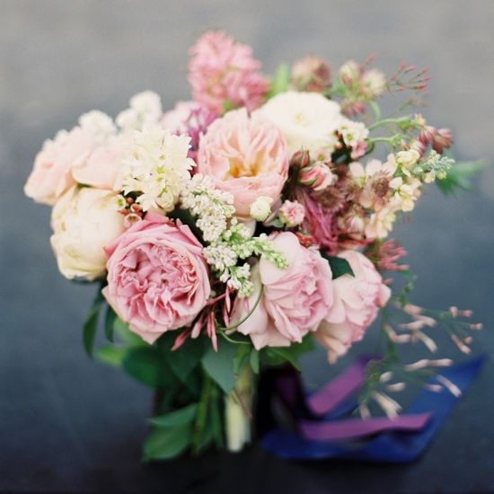 Romantic bouquet of pink roses and garden flowers