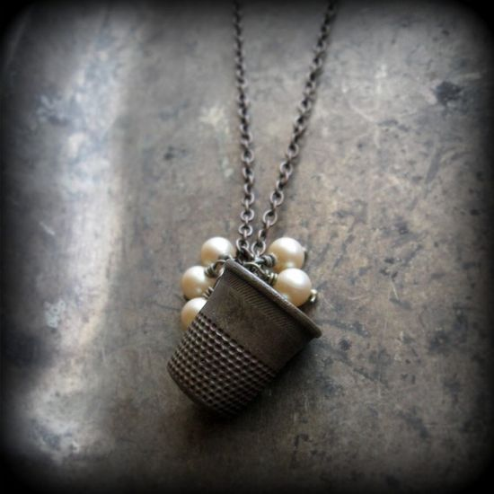 thimble and pearl necklace
