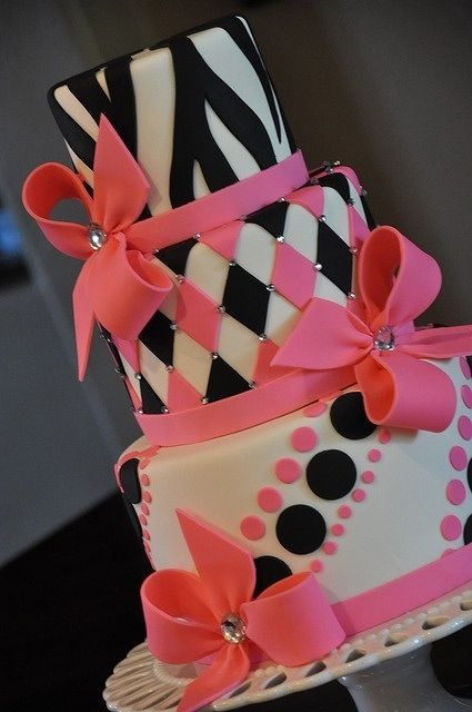 Cool Black, White, and Pink Cake. I like the bows and and the bottom tiers.  #Cake #Dish #Birthday #pastry   www.marine-engine... www.oreplus.in www.vessel-charte...