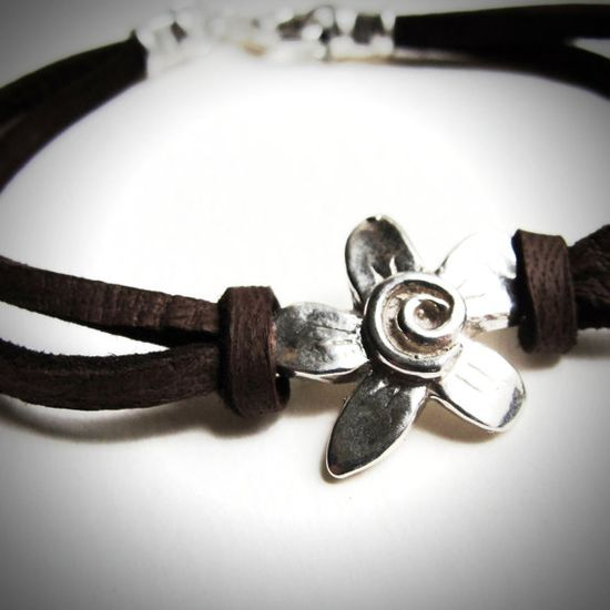 Sterling Spiral Fleur on Leather bracelet by JewelryByMaeBee on Etsy.