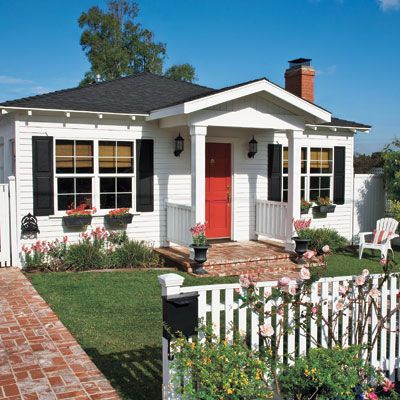 Small house, lots of curb appeal, Symmetrical:0) My favorite Before and After EVER!