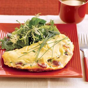 Bacon & Goat Cheese Omelet with Salad ~ Goat cheese, with its distinctive tart flavor, makes a delicious statement in this classic omelet recipe. Serve these individual omelets for brunch, lunch, or a light dinner.