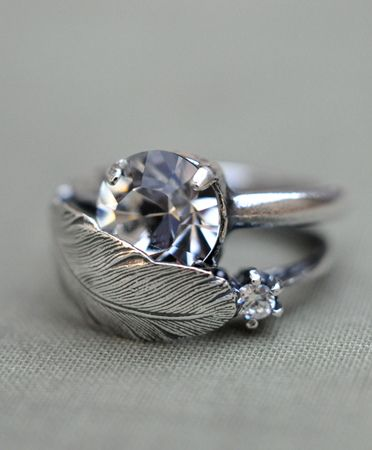 I love this feather and rhinestone ring