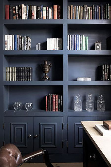 dark blue built in bookcases