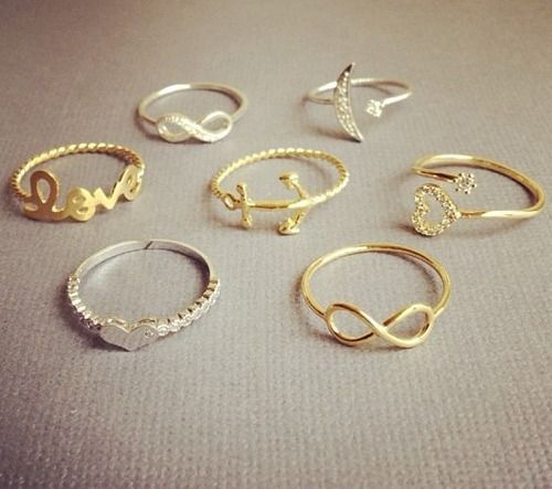 Love the infinity sign ones.. put a small diamond on it and id take it as an engagement ring