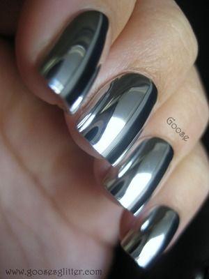 Metallic silver gel nail manicure art