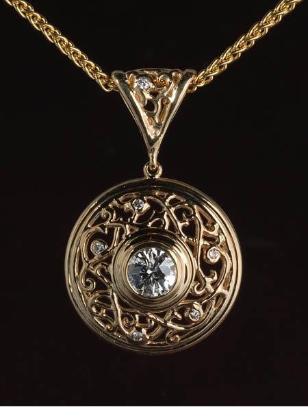 18K Yellow gold diamond (0.56 ct F/VS1 Jubilant Crown cut) and diamond (0.06 ct tw) pendant