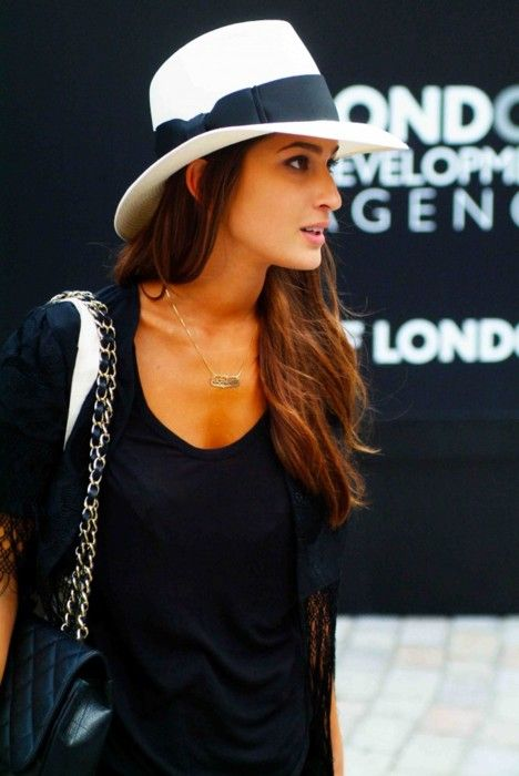 white hat topping an all black look