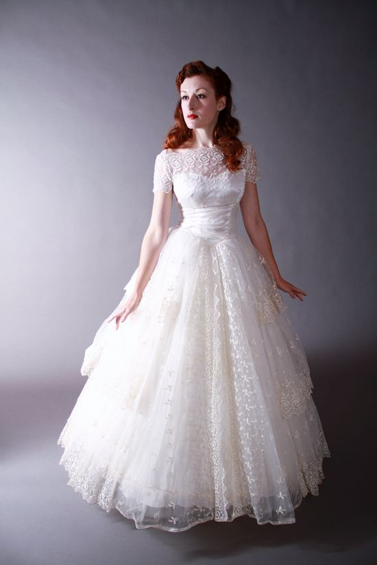 Vintage 1950s Wedding Gown  - Wow!  Between the silhouette of the dress and the amazing lace, this is one stunning wedding dress.