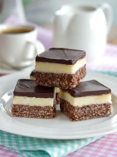 Nanaimo Bars, unequivocally one of the tastiest foods to ever originate on Canadian soil. #Canadian #food #dessert #Canada #Nanaimo #bars #chocolate #custard #baking