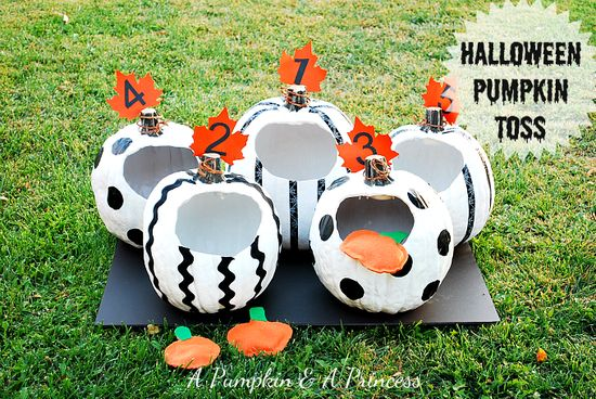 Pumpkin Toss Game - spray paint the inside of the pumpkins with glow in the dark paint so the kids can play this game after dark.