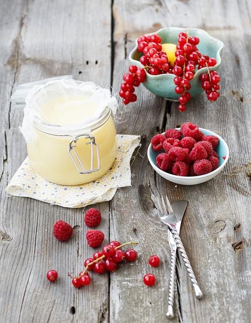 Lemon curd with berries for breakfast by Julia Khusainova, via Flickr