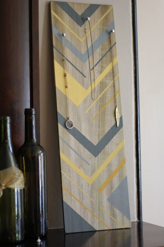 Grey and yellow painted wood Jewelry display