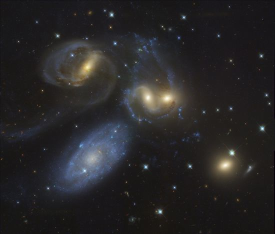 Stephan's Quintet  Image Data: Hubble Legacy Archive, ESA, NASA; Processing: Al Kelly    Explanation: The first identified compact galaxy group, Stephan's Quintet is featured in this eye-catching image constructed with data drawn from the extensive Hubble Legacy Archive. About 300 million light-years away, only four of these five galaxies are actually locked in a cosmic dance of repeated close encounters.