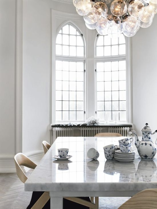 From the ceiling hangs the beautiful Hexagon from Flos. On the table a true classic, Musselmalet from Royal Copenhagen, inherited from my grandmother. The chairs are Monica Förster Antelope.