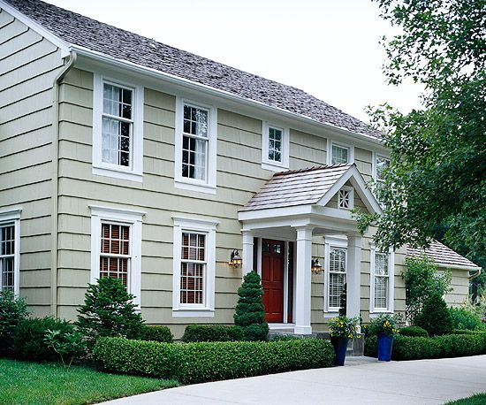 White molding adds classic style to this simple facade. See more ways to update your home: www.bhg.com/...