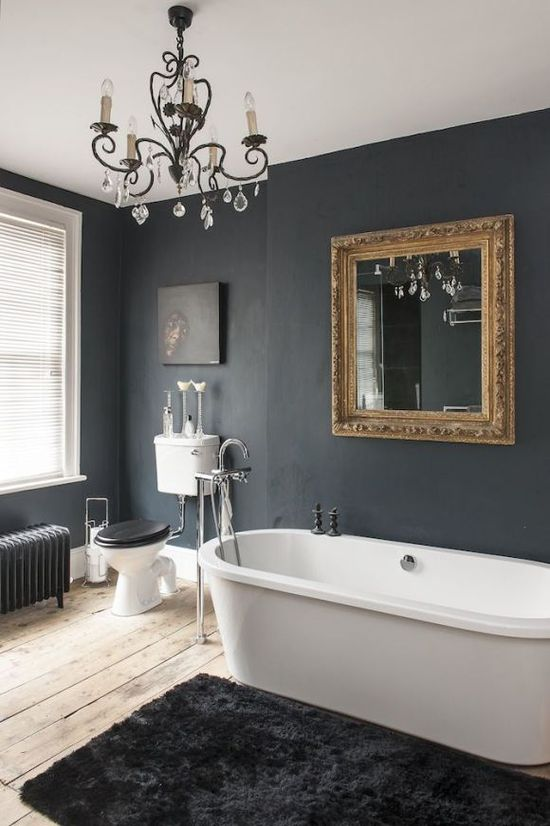 This gold frame really pops on the dark walls in the bathroom.