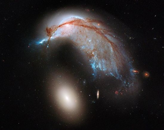 """A Galaxy That Looks Like a Hummingbird. Because Why Not."" - Bad Astronomy"