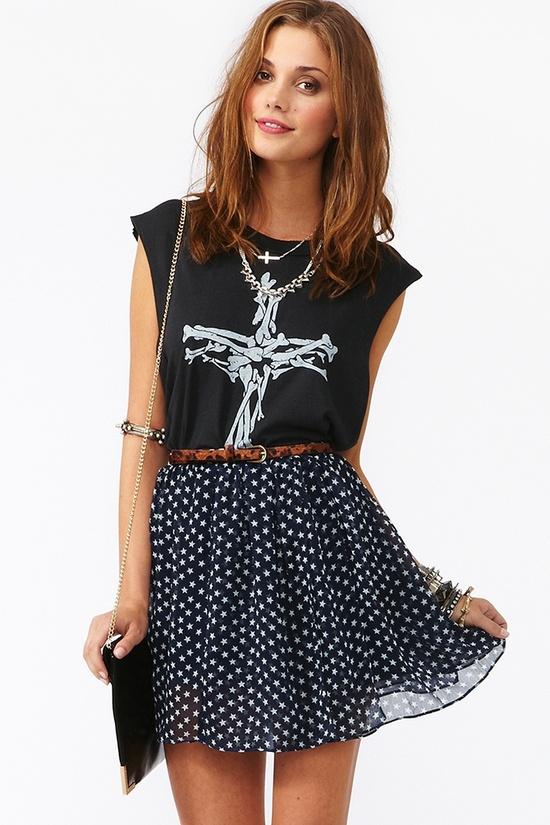T-Shirt and polka dot skirt.