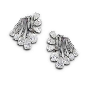 HARRY WINSTON. A PAIR OF PLATINUM AND DIAMOND EARCLIPS.