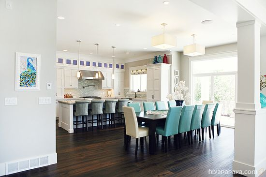 House of Turquoise: Kitchen and open floor plan with long dining table
