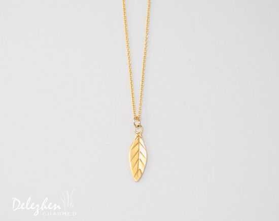 Gold handmade leaf necklace// modern jewelry  by DelezhenCharmed, $24.00 #delezhenCharmed #leafCharm #Leaves #Minimalist
