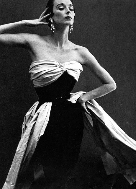 Paris Studio, August 1949    Wearing a strapless gown by Cristóbal Balenciaga. Photographed by Richard Avedon.